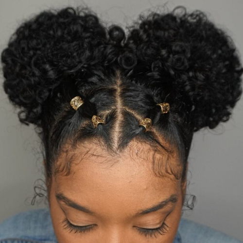 Two curly puffs with gold accessories.