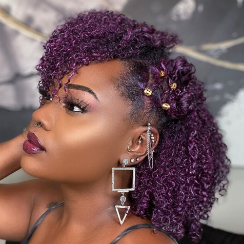 Wash and go on purple hair with gold accessories on the side.