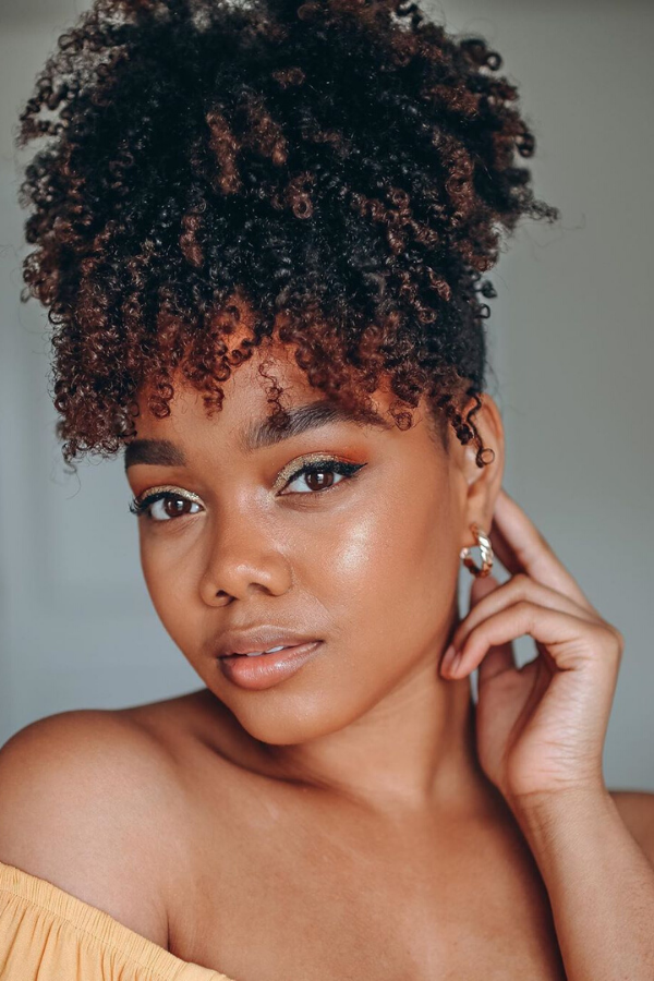 high puff with curly bangs.