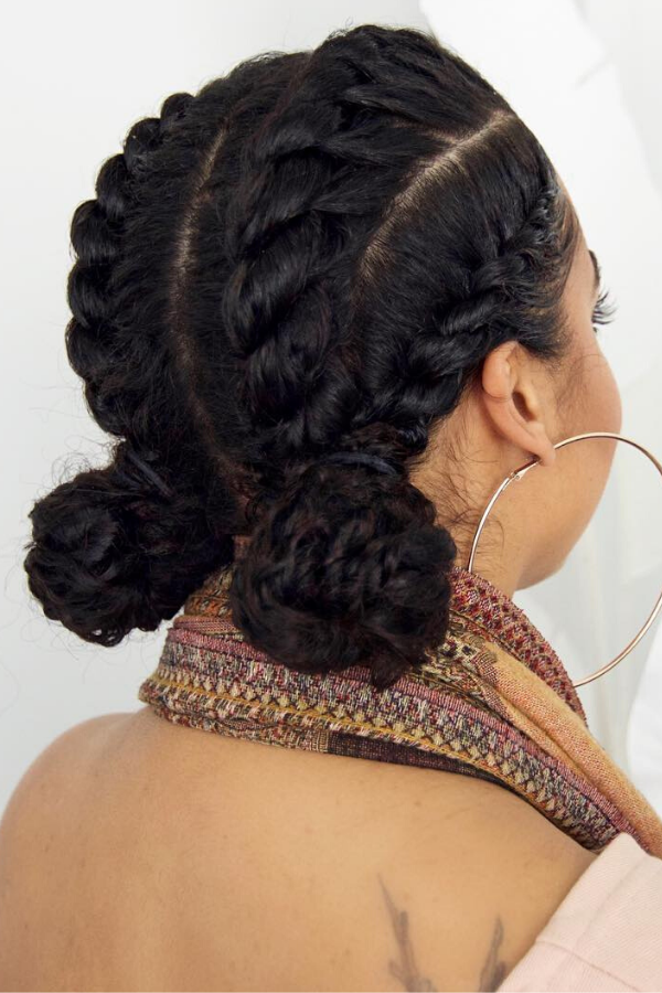 Four jumbo flat twists put into two low buns.