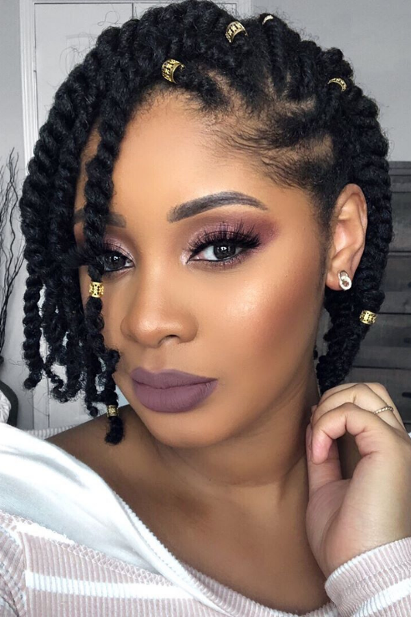 Two strands twists and flat twists with gold hair accessories.