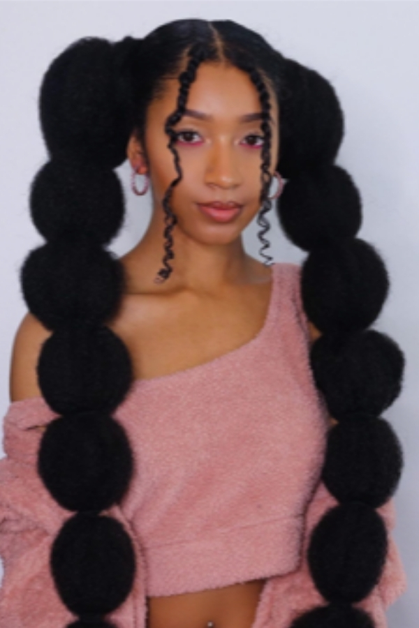 Natural Hairstyles - Two puff ball ponytails.